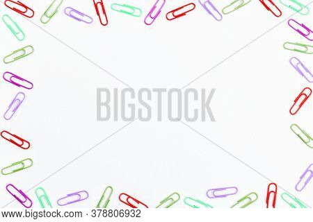 Colorful Paper Clips. Frame With Paper Clips With Copy Space For Text.