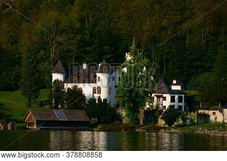 Three-tower Castle, Built In 1522, Located On Lake Hallstatt Exactly In Front Of The Town.it Was Own