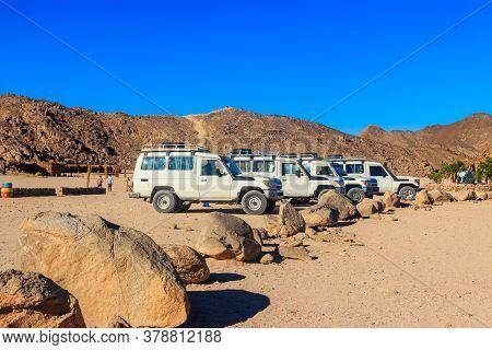 Off Road Suv Cars In Bedouin Village In Arabian Desert Near Hurghada, Egypt