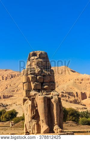 Colossi Of Memnon, Two Massive Stone Statues Of Pharaoh Amenhotep Iii In Luxor, Egypt