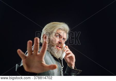 Handsome Man Talking At Retro Handset. Communication. Bearded Man With Handset. Male Talking On Land