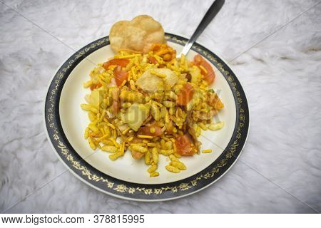 Bhel Puri Savoury Snack Chaat Item From India. Popular Road Side Foos Dish Served In Plate Spoon. Ma