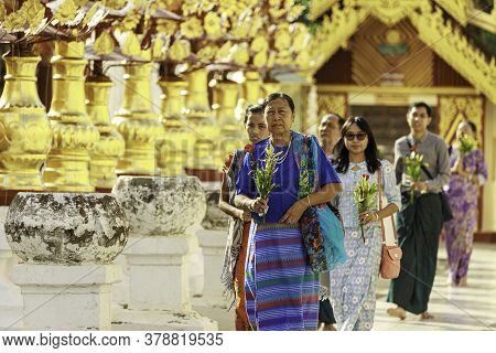 Bagan/myanmar-october 4th 2019: A Group Of Burmese People Are Carrying Flowers To Pay Respect To Bud