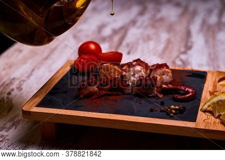 Night Photography Of A Plate Of Octopus And Oil With Salad