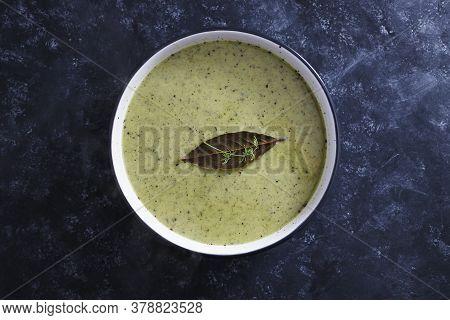 Healthy Plant-based Food Recipes Concept, Vegan Zucchini Pesto Soup Wth Rice Milk