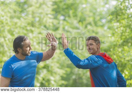 Two Men After Workout Giving High Five. Active And Healthy Lifestyle Concept. Outdoor.