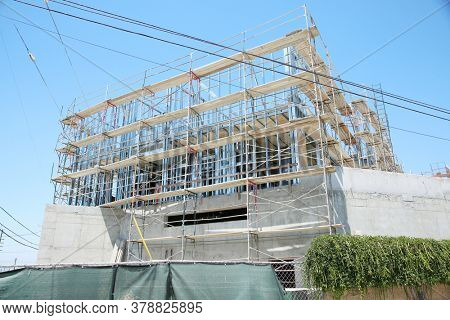 Construction Site. Building Construction Site with Metal Frames. Industrial building being built by contractors outdoors. Office Building.