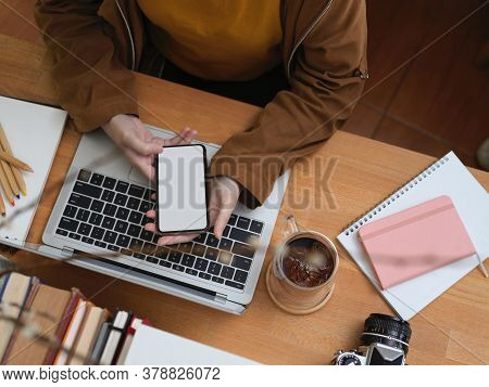 Female Office Worker Using Smartphone While Sitting At Worktable, Clipping Path.