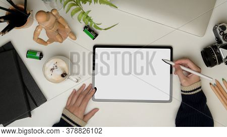 Female Hands Using Digital Tablet With Clipping Path On Office Desk