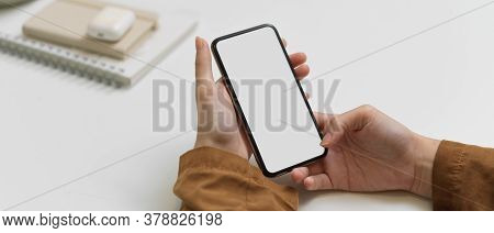 Female Hands Using Smartphone With Clipping Path On Office Desk