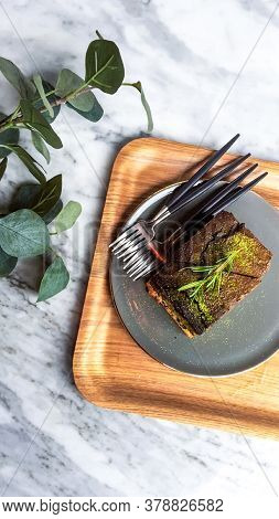 Top View Matcha Brownie With Fork On A Marble Stone Table