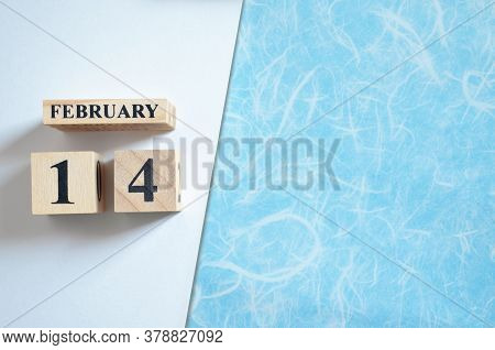 February 14, Empty White - Blue Background With Number Cube.