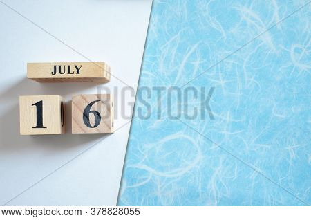 July 16, Empty White - Blue Background With Number Cube.