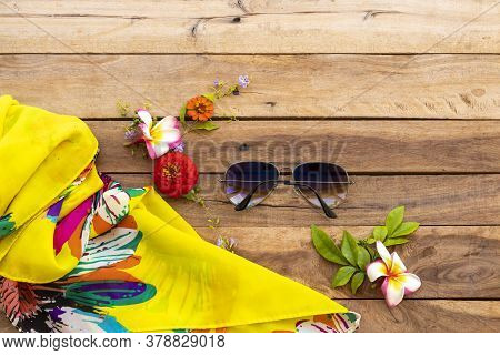 Sunglasses And Yellow Scarf Of Lifestyle Woman Relax Summer With Flowers Zinnia ,frangipani Arrangem