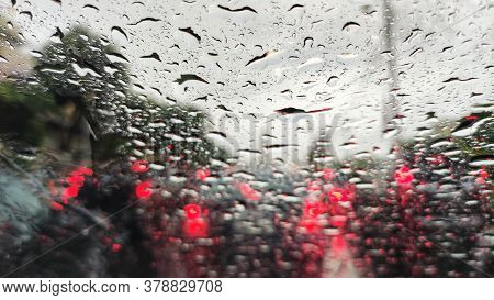 Caught In Thunderstorm. Car Windshield Splash By Heavy Rain Water From Storm. Heavy Traffic Congesti