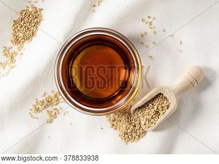 Sesame Oil And Scoop Placed On A Cloth