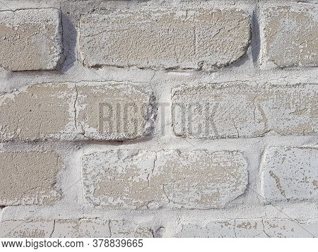 Grey Brick Wall Background With Sunlight And Shadows Close Up