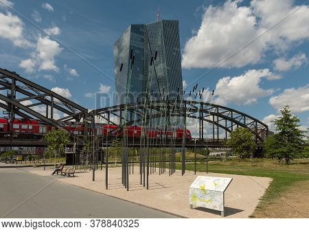 Frankfurt Am Main, Germany-july 28, 2020: Deutschherrnbruecke With Red Train In Front Of The Europea