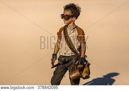 Post Apocalyptic Fighter Boy Outdoors In The Desert. People In Nuclear Post-apocalypse. Life After D