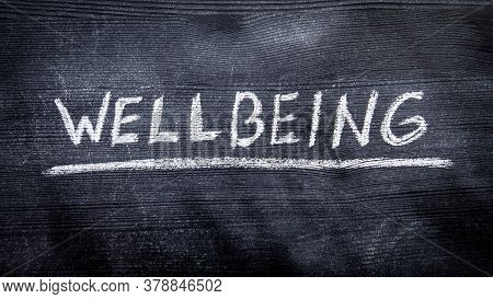 Wellbeing. Black Painted Wood And Inscription With Chalk
