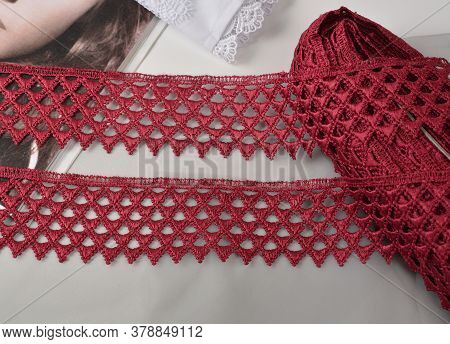 Tapes Of Red Vinous Gentle Guipure, Beauty Silk Lace Fabric On Light Background. Elastic Material. U