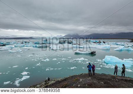 Jokulsarlon, Ice Lagoon, Iceland- 23 August 2015: Tourists Watching The Famous Glacial Lake With Ice
