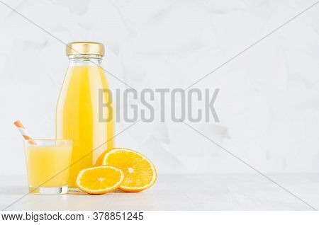 Fresh Juicy Orange Juice In Glass Bottle Mock Up With Wine Glass Decorated Straw, Fruit Slices In So