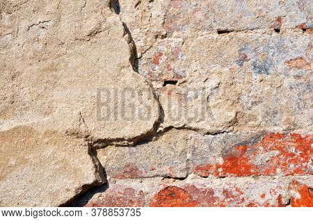 Empty Old Brick Wall Texture. Shabby Facade Of A Building With Damaged Plaster.