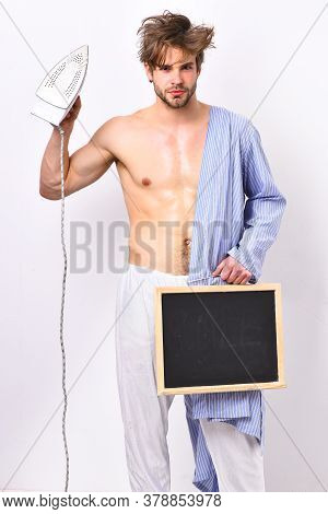 Man With Muscular Body Hold Iron Everyday Life And Housework.