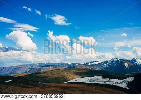 Sunlight In High Mountain Valley Near Beautiful Glacier On Hillside. Sunny View To Snowy Rocky Hill