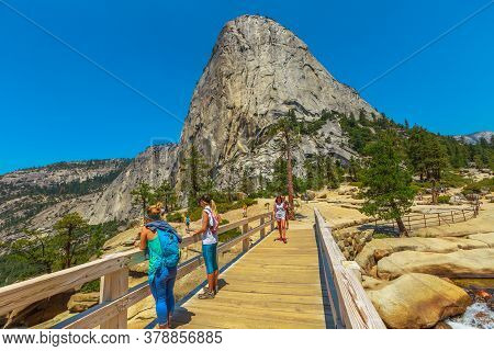 Yosemite, California, United States - July 24, 2019: Liberty Cap Top View From The Bridge Of Nevada