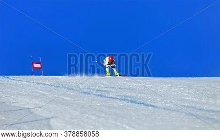 Alpine Skiing Race. Man Mountain Skier In Background Blue Sky