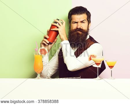 Funny Handsome Bearded Barman On Purple Green Studio Background