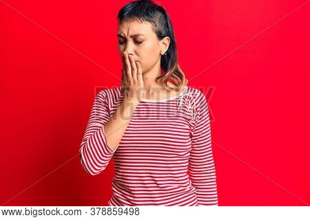 Young woman wearing casual clothes bored yawning tired covering mouth with hand. restless and sleepiness.