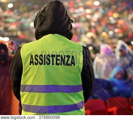 Boy With High Visibility Jacket And  Text Assistenza That Means Assistance In Italian Language Durin