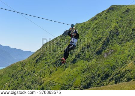 Boy On The Cable Track Of Mount Tamaro On Switzerland