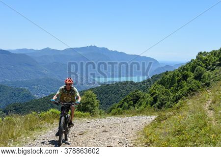Man On His Mountain Bike At Mount Tamaro On The Swiss Alps