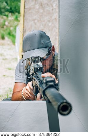 Rifle Machine Gun Combat Shooting Training From Behind And Around Cover Or Barricade. Advanced Fight
