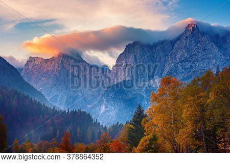 Triglav Mountain Peak At Sunrise With Beautiful Clouds In Morning Light. Slovenia, Triglav National