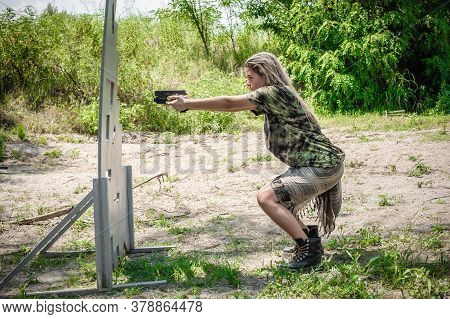Attractive Female Army Soldier Have Gun Shooting Training Around Cover