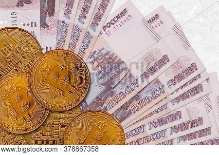 500 Russian Rubles Bills And Golden Bitcoins. Cryptocurrency Investment Concept. Crypto Mining Or Tr