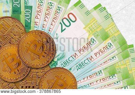 200 Russian Rubles Bills And Golden Bitcoins. Cryptocurrency Investment Concept. Crypto Mining Or Tr