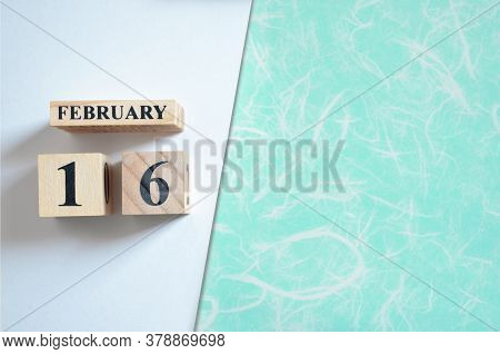 February 16, Empty White - Green Background With Number Cube.