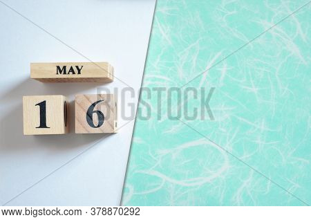 May 16, Empty White - Green Background With Number Cube.