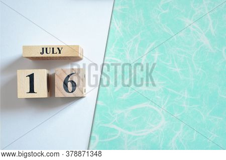 July 16, Empty White - Green Background With Number Cube.