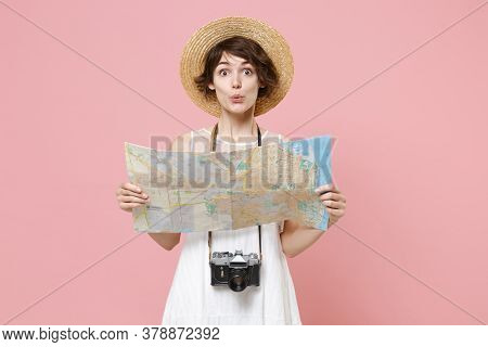Amazed Young Tourist Woman In Summer White Dress Hat With Photo Camera Isolated On Pink Background S