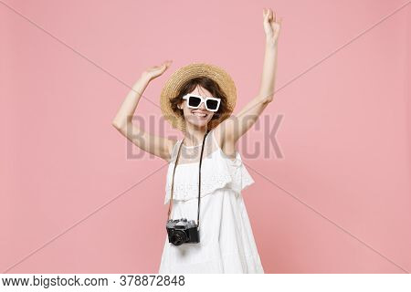 Cheerful Young Tourist Woman In Dress Hat Sunglasses With Photo Camera Isolated On Pink Background.