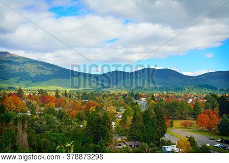 Gorgeous Autumn Day In Turangi Town With Magnificent Mountains Of Tongariro National Park In The Bac