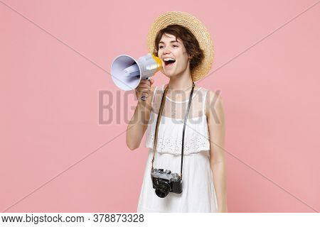 Cheerful Young Tourist Woman In Dress Hat With Photo Camera Isolated On Pink Background. Traveling A