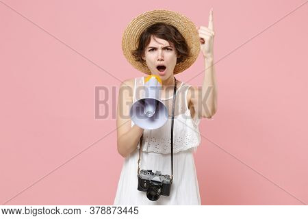 Dissatisfied Tourist Woman In Dress Hat With Photo Camera Isolated On Pink Background. Traveling Abr